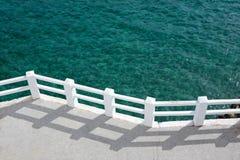 Promenade and Sunny Green Sea. Promenade, fence and Sunny Green Sea in Spain Stock Photography
