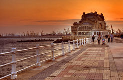Promenade at sunset. In Constanta,Romania.The building is a very famous and historical Casino Royalty Free Stock Photo