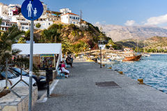 Promenade with tourists at harbour of Aghia Galini town on Crete island, Greece Royalty Free Stock Photo