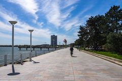 Promenade of Travemuende with a cyclist royalty free stock images