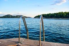 Promenade of Tribunj. City on the islands background , Croatia stock photos