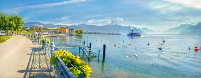 Promenade and view of Geneva Lake in Vevey town. Vaud canton, Sw. Panoramic view of Geneva Lake with beautiful embankment in Vevey town. Vaud canton, Switzerland Stock Photos