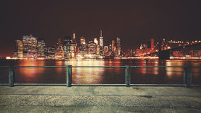 Promenade with view of Manhattan skyline at night, New York. Promenade with view of Manhattan skyline at night, color toning applied, New York City, USA Stock Images