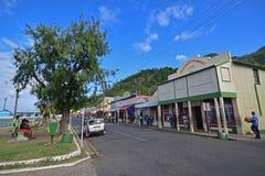 Promenade waterfront with local Fijian chatting and row of shops at Levuka, Ovalau island, Fiji Stock Photo