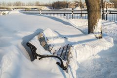 Promenade winter bench scene. The City of St. Eustache in Quebec, Canada is best known for its historical heritage and architectural heritage.Beautiful skate Stock Photo