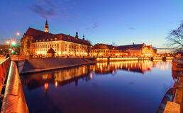 The promenade of Wroclaw, view from river Odra, after sunset. Stock Image