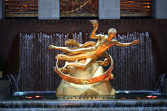 Prometheus in New york. The prometheus sculpture and water feature at the Rockefeller Centre in New york city. Premetheus was the Greek god of forethought and Stock Photos