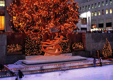 Prometheus statue at Christmas, New York. Ice rink and Prometheus statue in the Rockefeller Plaza at Christmas, New York, USA Royalty Free Stock Photo
