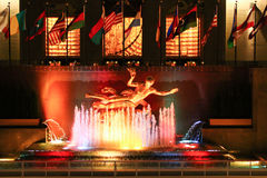 Prometheus Statue with colorful fountain and National flags at Rockefeller Center Stock Photography
