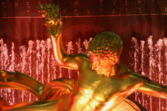 Promethus at Rockefeller Plaza. Golden Statue at the ice rink Royalty Free Stock Photos