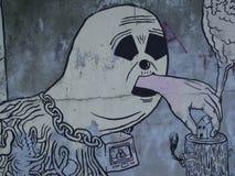 Promieniotwórczego symbolu rysunkowy łasowanie dom który drzeje od bagażnika przez ręki która opuszcza usta metafora zniszczenie obrazy stock