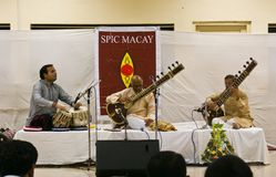 Prominent Indian musician playing Sitar live. Prominent Indian Sitar player (at centre), Ustad Shammim Ahmed Khan,along with his team, performing on stage live Stock Images