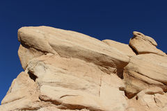 Prominent sandstone formation against sky Stock Images