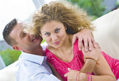 Promise. Portrait of young  attractive happy couple in domestic environment Royalty Free Stock Photography