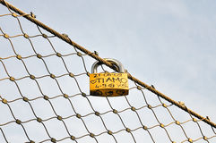 Promise of Love. With padlock on the metal net Stock Image