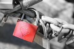 Promise of Love. Red padlock with an engraved heart Royalty Free Stock Images