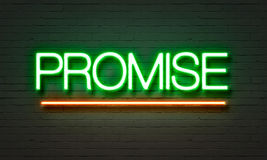Promise neon sign on brick wall background. Promise neon sign on brick wall background Stock Photography