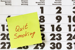 Promise the quit smoking. Sticker with promises on a calendar Stock Image
