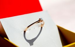 Promise ring. Red gold round brilliant diamond promise ring Royalty Free Stock Photo