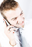 On A Promising Business  Phone Conversation. Young Corporate Man Having A  Promising Business  Phone Conversation Royalty Free Stock Photo