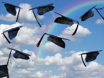 Airborne graduation caps with rainbow Stock Images