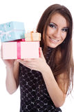 Promising holiday. Young girl smiling and holding festive boxes Stock Photos