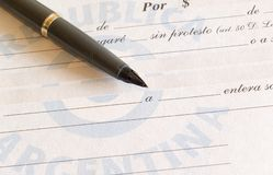 Promissory note and pen Stock Photos