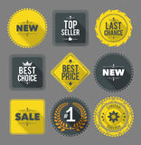 Promo badges and labels. Set of nine differently shaped design elements with long shadows. EPS10 Stock Images