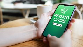 Promo code Discount coupon number field on mobile phone screen. Business and marketing concept. Promo code Discount coupon number field on mobile phone screen royalty free stock images