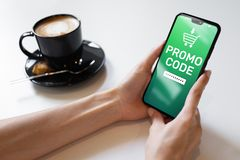 Promo code Discount coupon number field on mobile phone screen. Business and marketing concept. Promo code Discount coupon number field on mobile phone screen royalty free stock photography