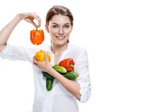 Promo girl holding a paprika and cucumbers - isolated on white Stock Photo