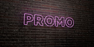 PROMO -Realistic Neon Sign on Brick Wall background - 3D rendered royalty free stock image. Can be used for online banner ads and direct mailers Royalty Free Stock Photography