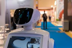 Promo robot to work at exhibitions. Robot guide. Modern technologies in advertising, promotion and presentation. Royalty Free Stock Images