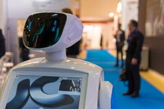 Promo robot to work at exhibitions. Robot guide. Modern technologies in advertising, promotion and presentation. Royalty Free Stock Photos
