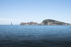 Promontory of Gaeta with sailing boat seen from the sea stock images