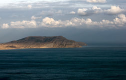 Promontory in the sea Royalty Free Stock Image