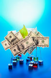 Promote. Colorful clips to hold banknotes. Blue background Royalty Free Stock Images