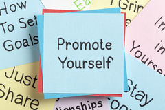 Promote Yourself. Top view of Promote Yourself handwritten on a note stock photos