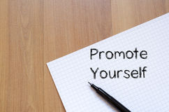 Promote yourself write on notebook Stock Image