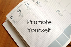 Promote yourself write on notebook Stock Photos