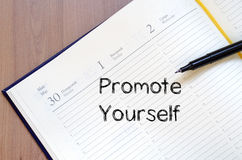 Promote yourself write on notebook Stock Photography