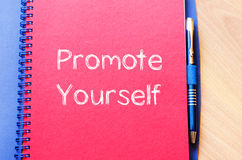 Promote yourself write on notebook Stock Photo