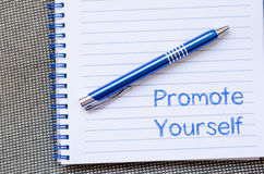 Promote yourself write on notebook Stock Images