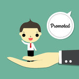 Promoted. Big hand carry businessman and speaking is  promoted  on green-blue background Royalty Free Stock Photo