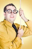 Promoted employee climbing up corporate rope Royalty Free Stock Photo