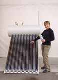 Promoter of solar technology. Young women promote solar panel Royalty Free Stock Image