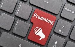 Promoting key on keyboard. Red promoting key on keyboard Royalty Free Stock Photo