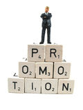 Promotion. A anager standing on the word promotion stock photo