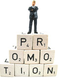 Promotion close-up. A close-up picture of a manager standing on the word promotion stock images