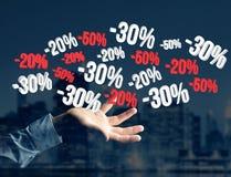 Promotion des ventes 20% 30% et 50% volant au-dessus d'une interface - Shopp Photographie stock libre de droits